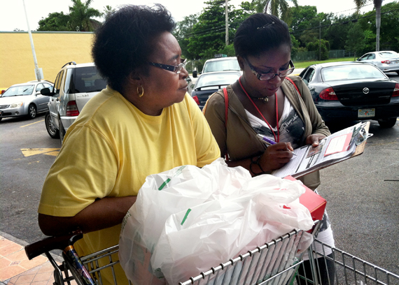 Barbara Johnson from the National Council of La Raza registers Willie Mae Dixon, 68, of Miami, to vote outside a grocery store in the Little Havana neighborhood of Miami, May 31. Photo by Ethan Magoc/News21
