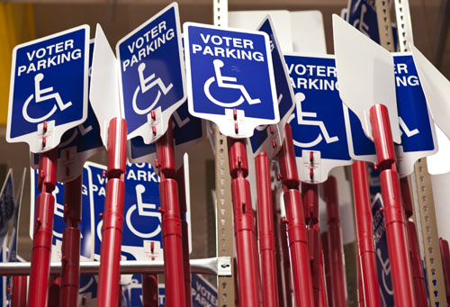 Disabled voter parking signs are stored inside the Maricopa County Elections Department warehouse in Phoenix. The signs provide access for disabled voters at polling locations in Maricopa County. Photo by Jeremy Knop/News21